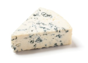A wedge of gorgonzola, a type of bleu cheese, on white.
